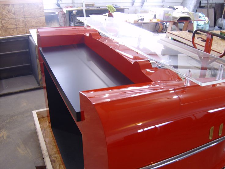 Side view of the reception desk from from a real front end of a car! perfect for a car dealership front desk, an Auto Repair shop or even as a unique restaurant hostess stand!
