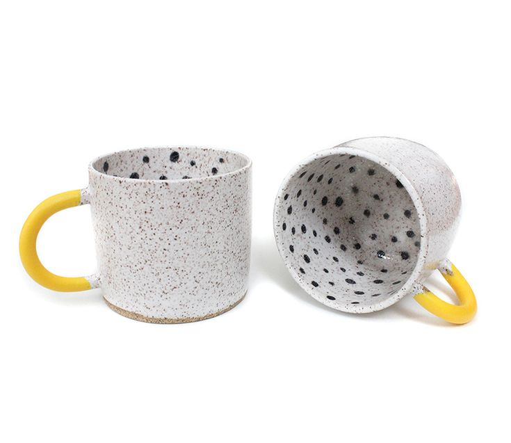 Made to order — please allow up to 8 weeks before shipment. All made to order items are final sale.  Staring down that first cup of early-morning coffee can be a grim experience; Josephine Heilpern's Rubber-Dipped Dot Mug is here to make things better. Under the name Recreation Center, Heilpern makes mugs that owe their graphic treatment to her background in printmaking. A white-glazed speckled stoneware interior is hand-painted with black polka dots, and its handle dipped in the happiest…