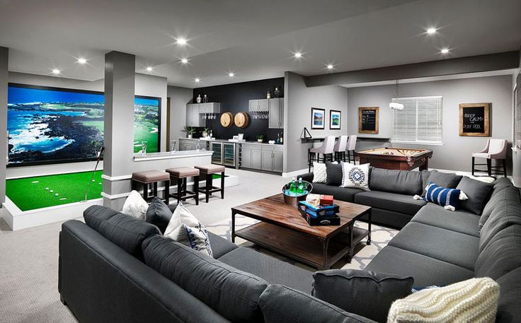 Man cave with sectional couch, indoor golf green and home bar
