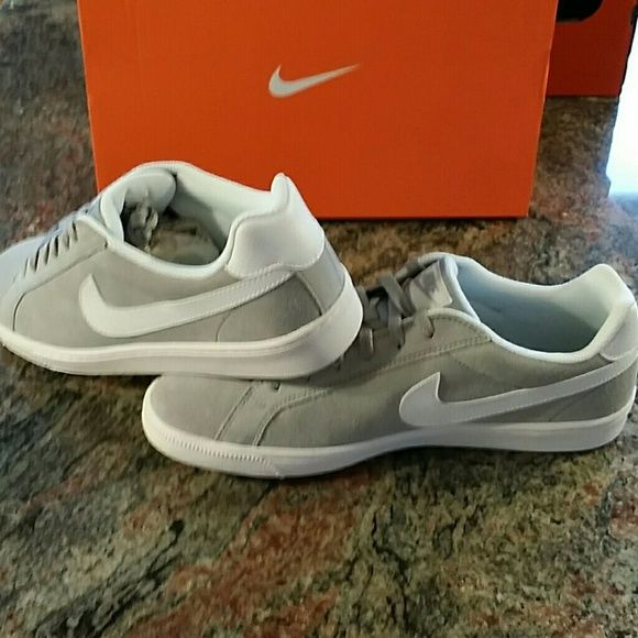 NEW Nike shoes gray and white Brand new never used or worn. Men's size 11.5 which fits women's size 13 Nike Shoes Sneakers