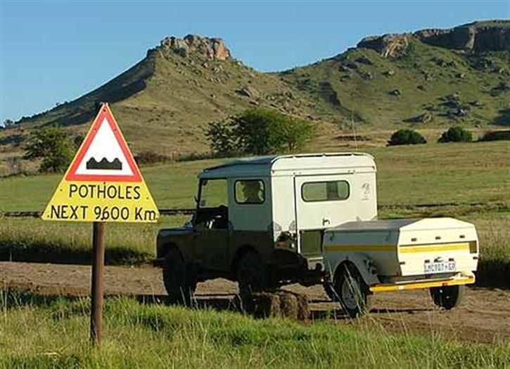 Funny African Road Signs: Potholes For The Next 9600Km?