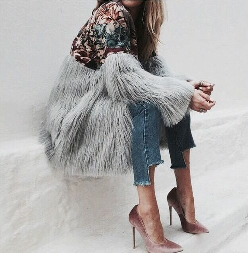 Embroidered jacket with faux fur sleeves, high-low jean hemline and blush pink velvet pumps.
