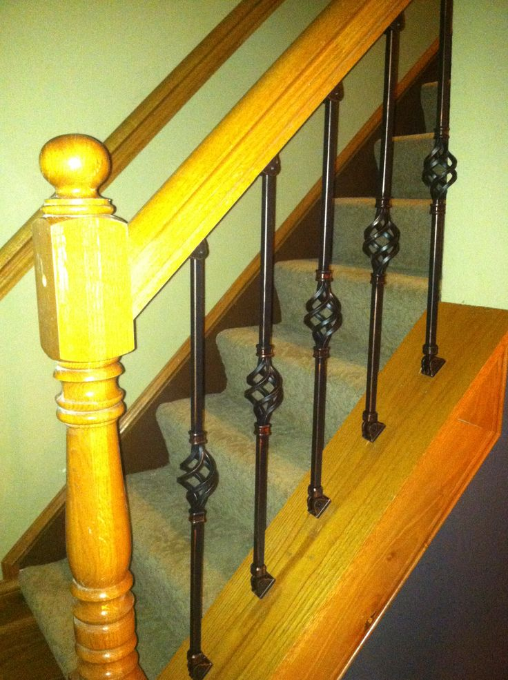 Stair Redo  Deep Brown Paint On Stringers, Wood Trim And Wrought Iron  Balusters Give