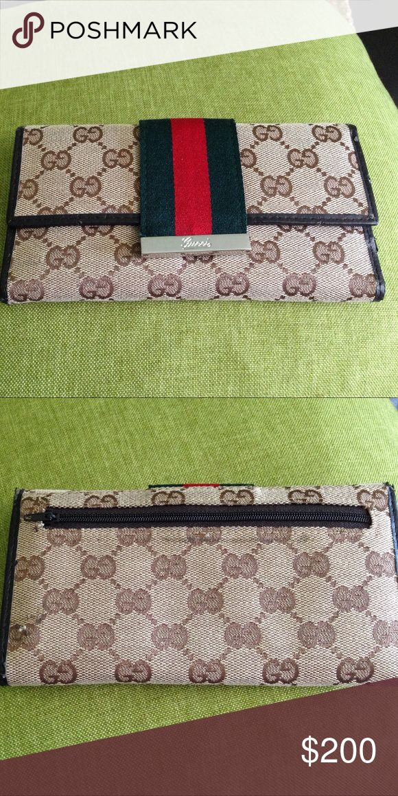 Gucci wallet Gucci wallet brown color. Used a couple of times. Minor scratches. Good condition. Gucci Bags Wallets