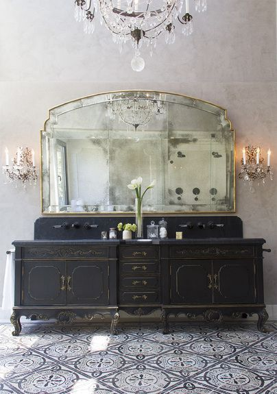 Black Antique Double Vanity - with wall-mounted faucets, surrounded by vintage lighting and a beveled wall mirror.