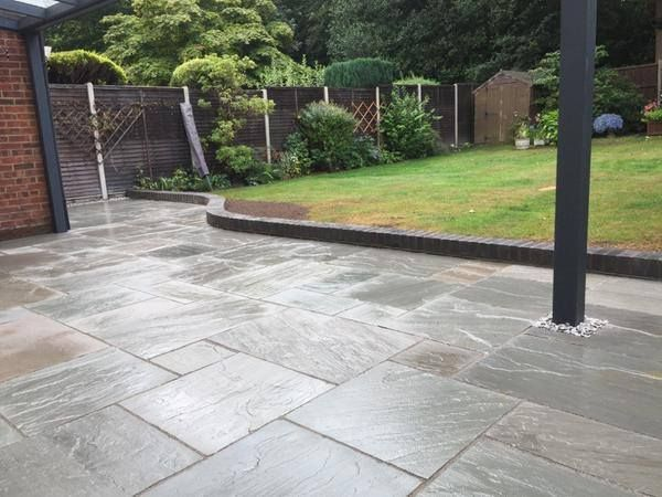 ethan mason silver grey natural stone paving this garden patio has been beautifully created
