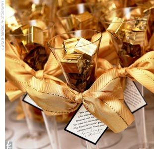 Gold accent favors that reflects the classic Hollywood era.