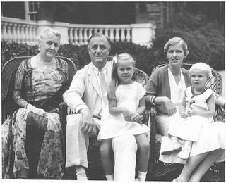"Franklin D. Roosevelt seated in front of his home ""Springwood"" at Hyde Park, New York.  L-R,  Sara, FDR, Sistie, Anna Roosevelt Halsted, and Buzzie. 7/17/1932."