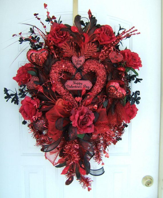 Hello,    I am so glad you took the time to stop in and take a look around. This sale is for a UNIQUE floral Black & red Valentines Day wreath.