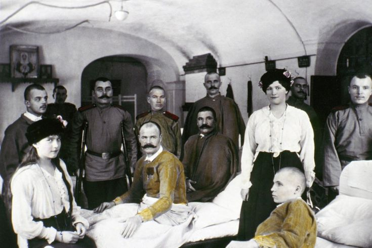 15 intimate snapshots of the Romanov family, shortly before their execution Anastasia (at left) and Maria visit wounded WWI soldiers in hospital.