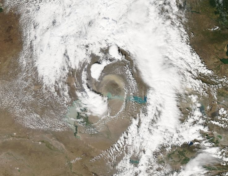 On August 26 the Moderate Resolution Imaging Spectroradiometer (MODIS) aboard NASA's Aqua satellite captured this true-color image of a spiraling dust storm in eastern Kazakhstan. Whirling clouds surround an arc of tan dust north of Lake Balkhash. The dust likely arises for the Saryeski-Atyrau Desert, a sand desert which stretches for about 250 mi (500 km) south of Lake Balkhash and between the Ili River (west) and Karatal River (east). Credit: Jeff Schmaltz, MODIS Land Rapid Response Team