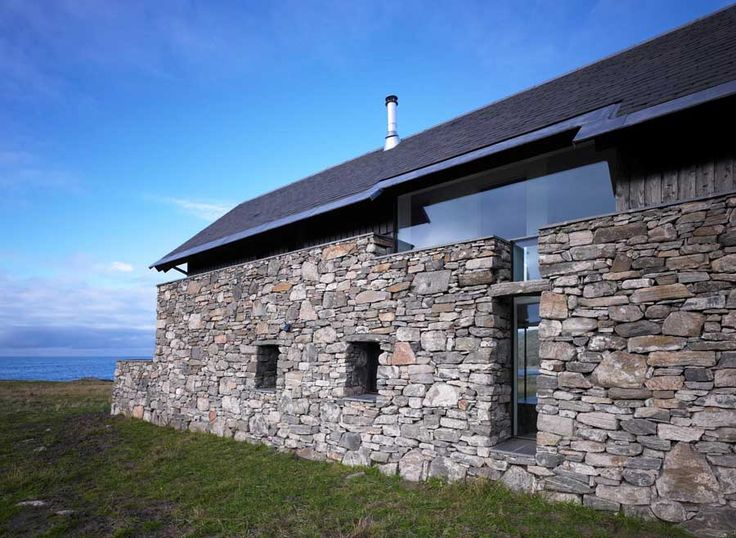 Scotland. A beautiful, modern home built largely inside old ruins.