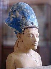 Small statue of Akhenaten wearing the Egyptian Blue Crown of War.