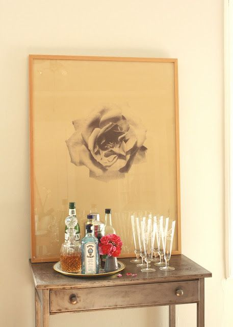 duh...i have the table to do this in the dining room for aperitifs.  Ideal table at your front door.