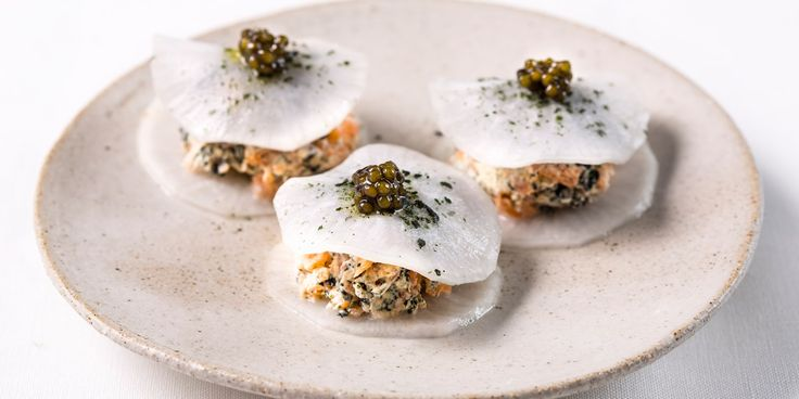 An artistic gluten-free canapé recipe from chef Robin Gill, this mini taco recipe features a soft mooli shell and creamy smoked salmon and nori seaweed filling. Topped with caviar to make it extra special.