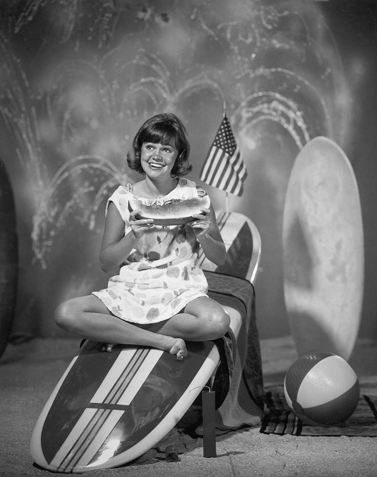 Loved this show!   Sally Field eating a watermelon on a surfboard for the television series 'Gidget,' 1965.