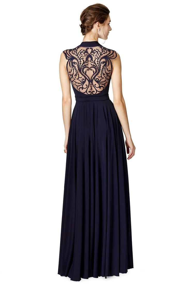 Glamorous black gown features beaded illusion bodice contoured fit