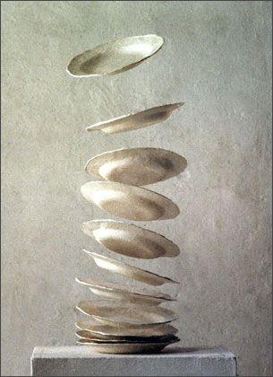 Plates.....Plaster, paper, nylon thread sculpture. Cornelia Konrads