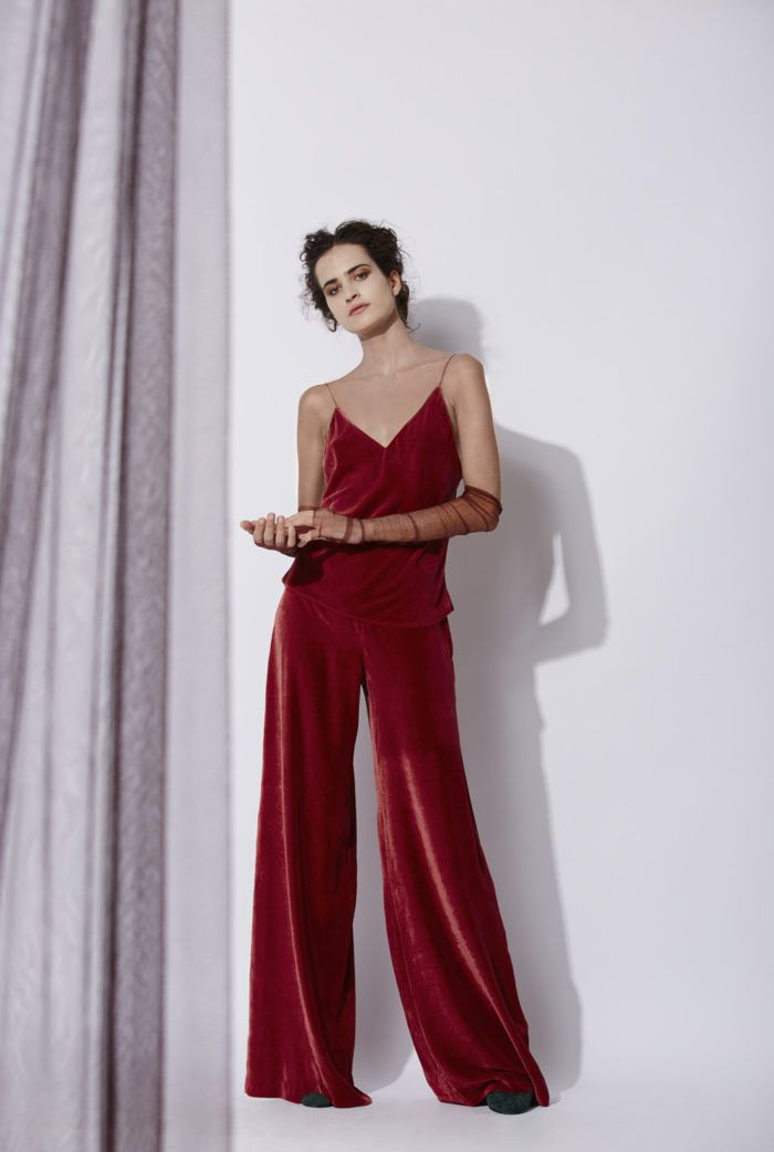 Ruby Tercio Pants: Velvet flared pants made of silk velvet with an invisible zipper down the front. This model can be combined with the Tercio top which is made of of the same material. It is available in black and ruby red. Made in Barcelona. Cortana AW 2016 collection. Shop online.