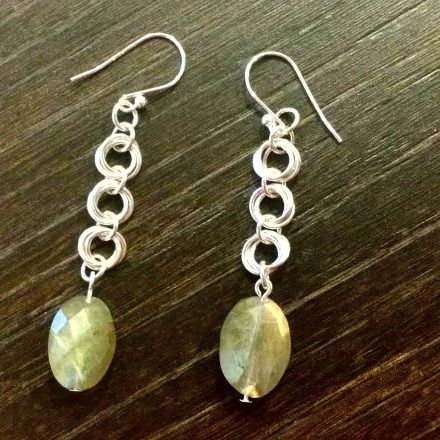 A pair of gorgeous earrings featuring three love knots with a labradorite crystal.  These simple earrings will add a touch of elegance to whatever you wear.