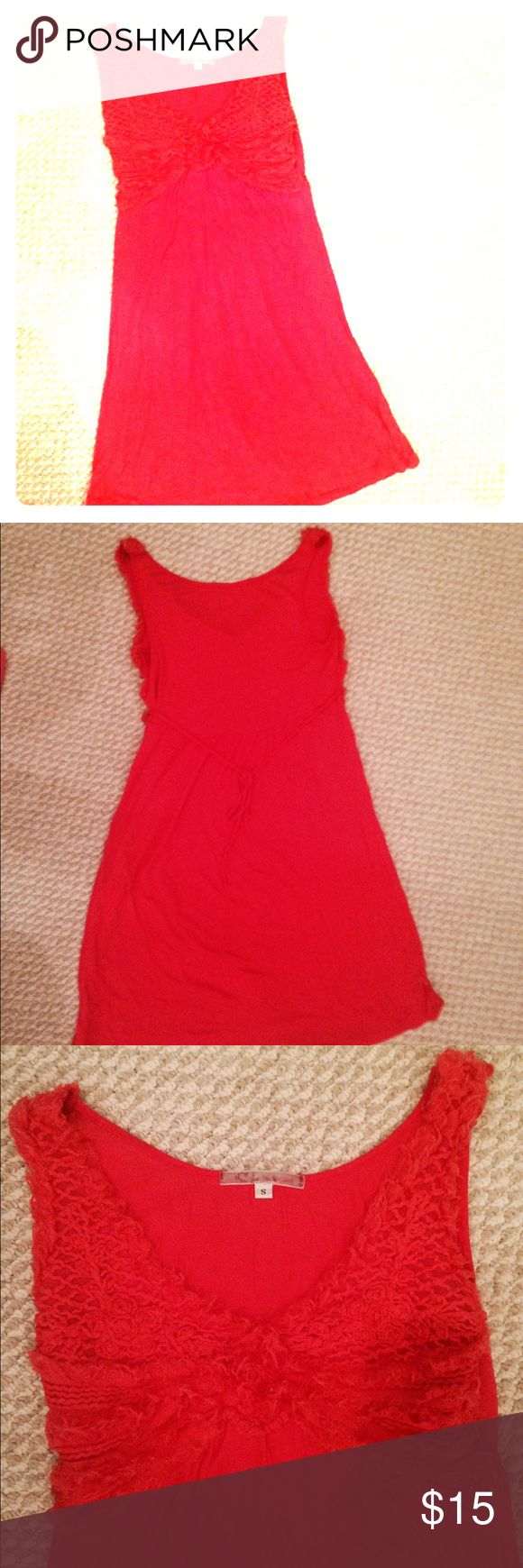 Coral lace This dress is very soft and comfortable with give in the fabric.  The front chest area is lace and ties in the back.  Perfect as a sundress or at the beach! Dresses