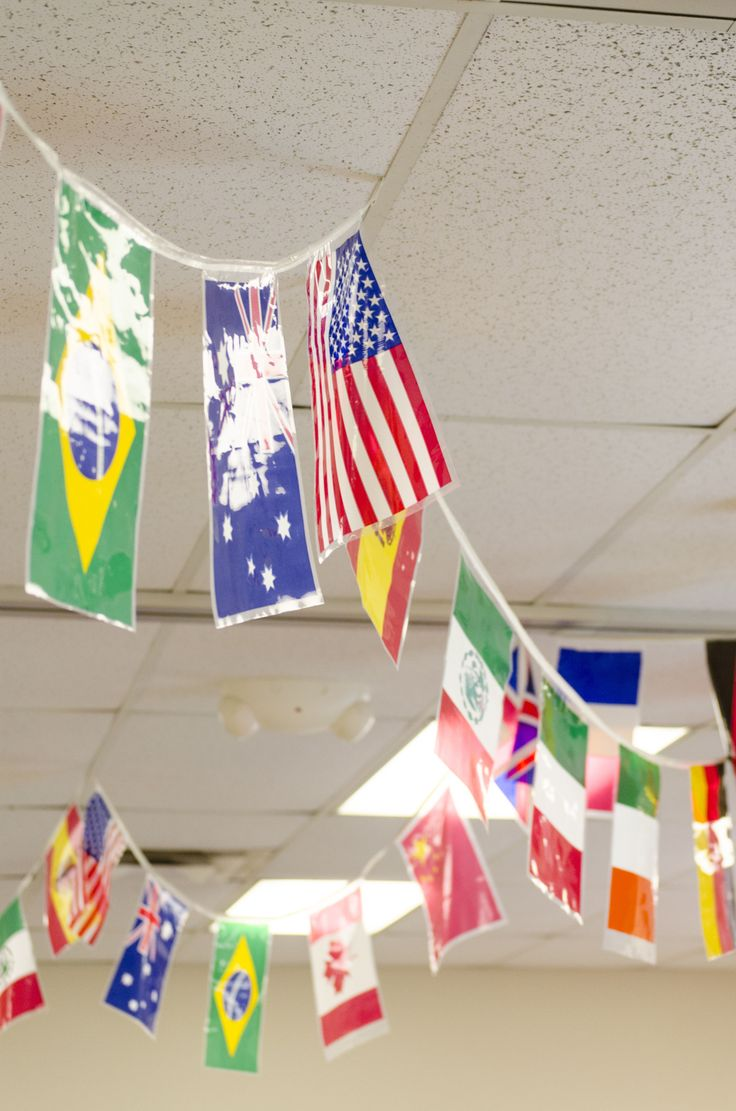 Strings of international flags do a great job decorating the ceilings