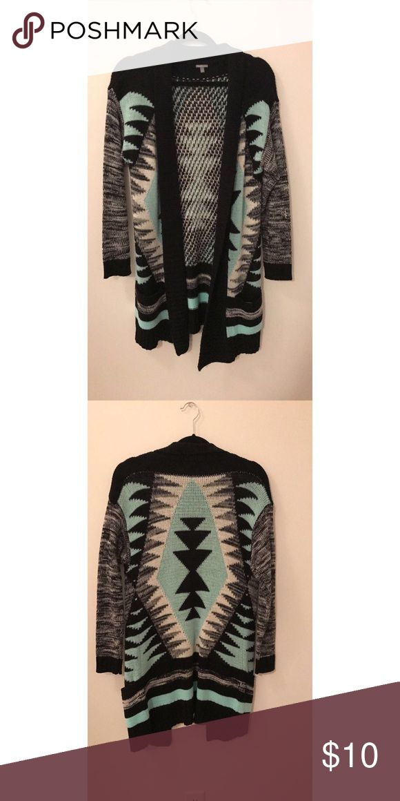 Thick Tribal Print Cardigan This thick cardigan is perfect for winter. It's practical for chilly days and cute enough to make an outfit. Charlotte Russe Sweaters Cardigans