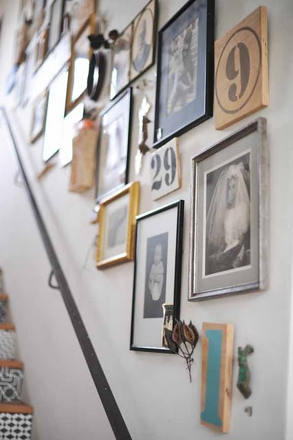 stair risers and gallery wall with hand rail