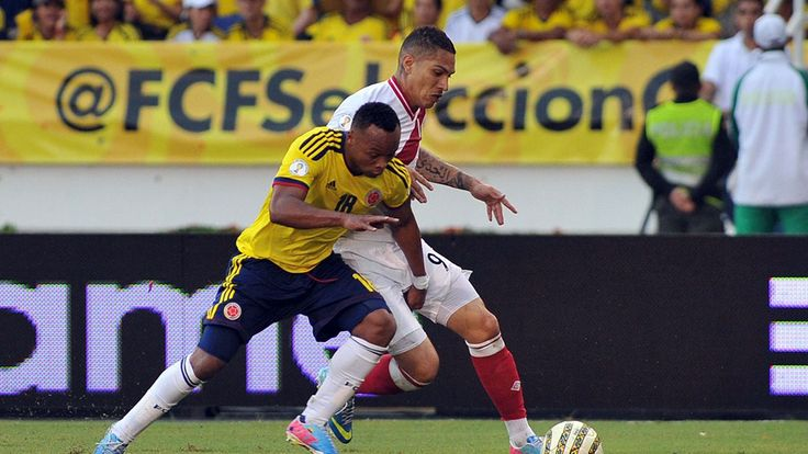 Colombian football player Camilo Zuniga (L) vies with Peruvian Paolo Guerrero during their FIFA World Cup Brazil 2014 South American qualifier football match at the Metropolitan stadium in Barranquilla, Colombia, on June 11, 2013. AFP PHOTO/Luis ROBAYO