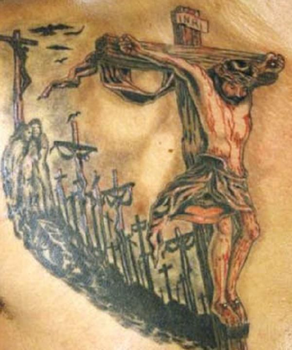 A trail of crosses following the large picture of Christ nailed on a cross with backdrop causing an illusion of another Christ.