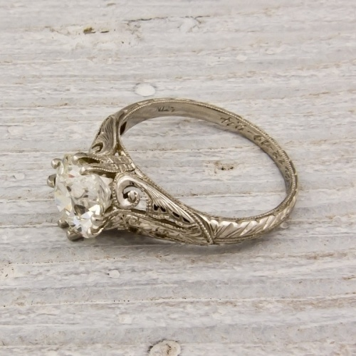 This 1.59 old European cut diamond engagement ring from Ertswhile Jewelry has an intricate floral motif etched into the band.