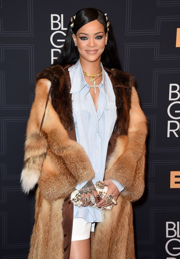 Rihanna rocks a shirt, shorts and fur as she mixes up her quirky wardrobe for annual BET event - Mirror Online