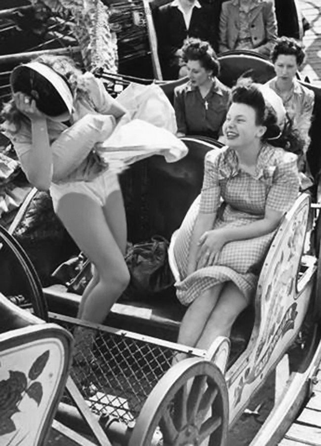 Windy carnival roller coaster ride. Woman in back seat is not amused. Vintage photo by René Maltête #perfectlytimed #renemaltete