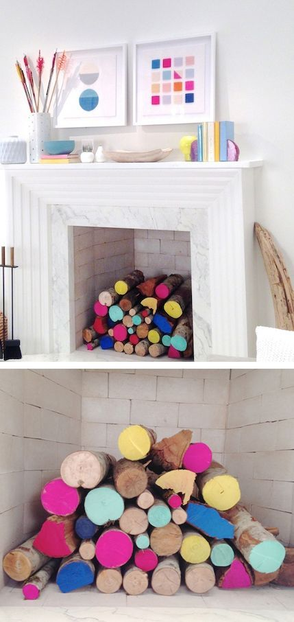 Brightly painted logs add a pop of sunny colour to this fireplace. A really easy and fun idea to add colour to a room.