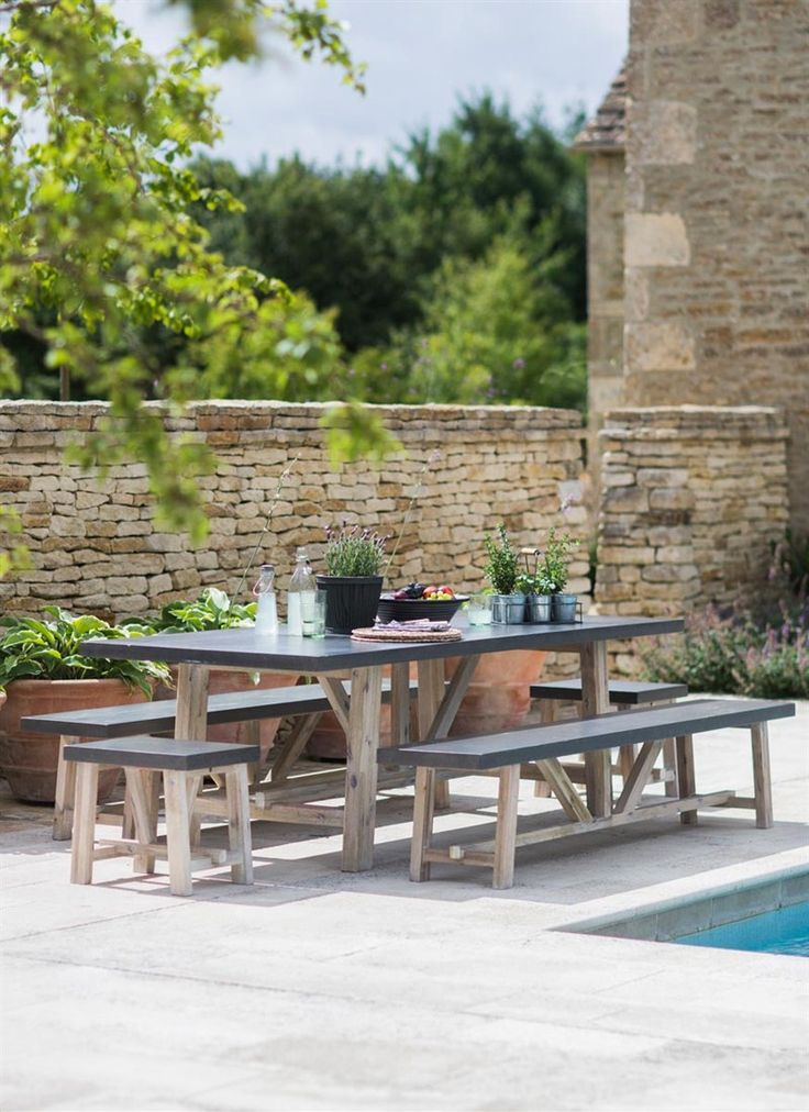 The stunning Chilson Table and Bench Set adds a classic but contemporary look to any garden