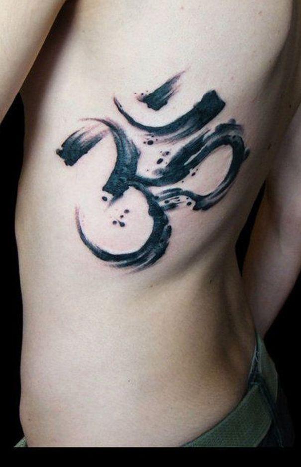 om tattoo on rib