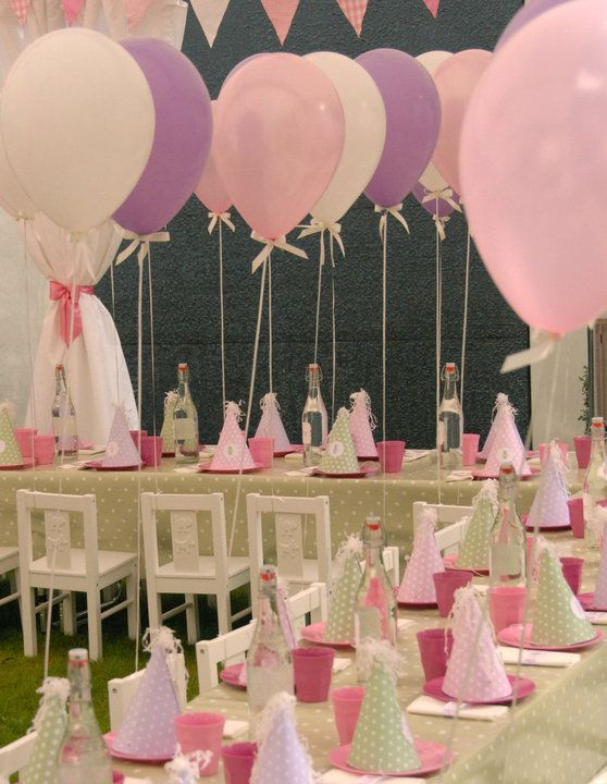 princess party. Balloon on each chair and party hat on each plate