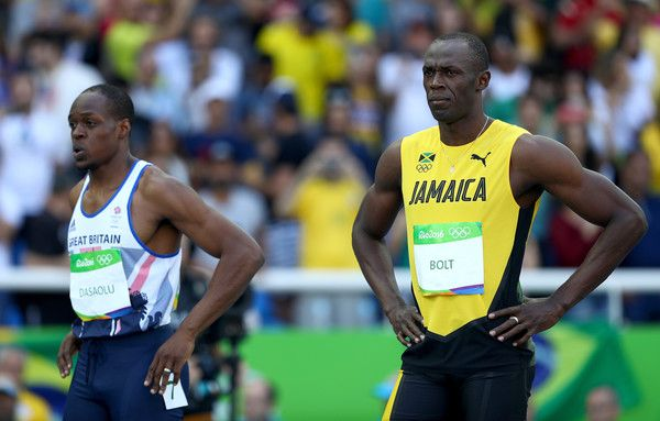 Usain Bolt Photos - James Dasaolu of Great Britain and Usain Bolt of Jamaica prepare to compete in round one of the Men's 100 Meters on Day 8 of the Rio 2016 Olympic Games at the Olympic Stadium on August 13, 2016 in Rio de Janeiro, Brazil. - Athletics - Olympics: Day 8