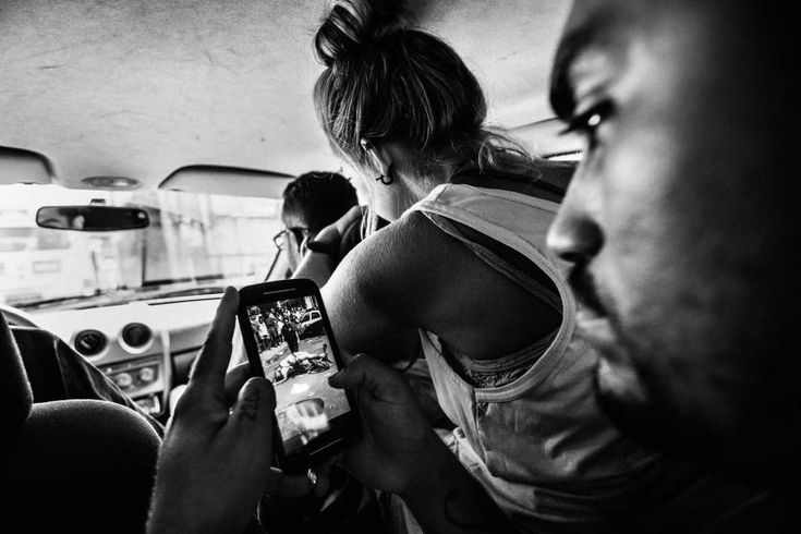 Daily Life, 3rd prize stories. The leader of the Papo Reto collective receives an image of a 22-year-old taxi driver who was shot dead by a police officer; Rio de Janeiro, Brazil, Feb. 8, 2015.