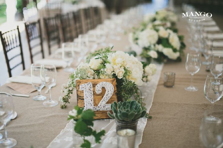 #weddings #photography #weddingideas #inspiration #number #flowers #green #white #beige #centerpiece #reception #event #design #table #glasses #mangostudios Photography by Mango Studios Venue: #KurtzOrchard