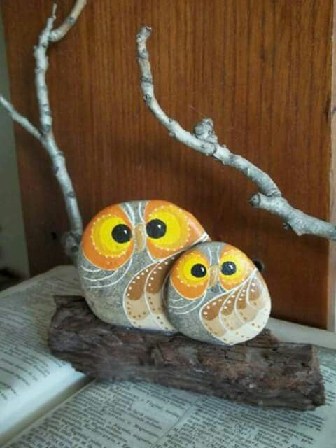 Rock owls on a branch