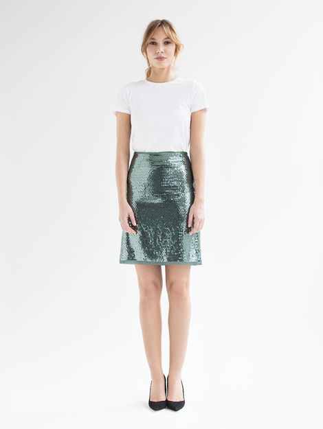 Iris- Made from embroidered fabric from Jakob Schlaepfer with shimmering sequins, the short shirt's A-line shape is both elegant and flirty. Swiss made