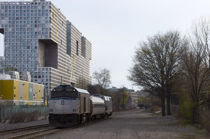 Amtrak train on the Grand Junction going by #MIT Simmons Hall dormitory #CambridgeMA