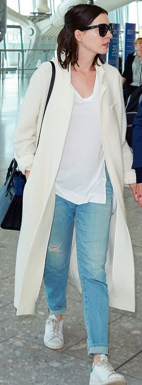 Who made Anne Hathaway's white sneakers, coat, and black tote handbag?coat – M. Martin  Shoes – Adidas  Purse – Saint Laurent