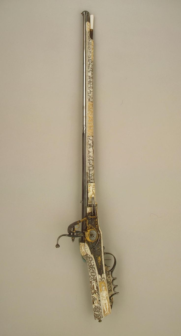 Gun  Germany, 1590-1600  Such hunting guns were known as arquebuses. Not only is this example of interesting construction, but its decoration is particularly rich and varied. The stock and butt are set with plaques of carved and gilded horn and then covered with fine carving and gilding. Amongst the many centres for the production of arms and armour in 16th- and 17th-century Germany, Munich specialized in the making of firearms. Hermann Fischer was one of the most famous of Munich masters.