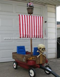 Homemade Pirate Ship Wagon and Pirate Costume: I try to steer clear of store bought costumes but my wife really liked this toddler pirate for our daughter. Since we were planning on pulling her in her