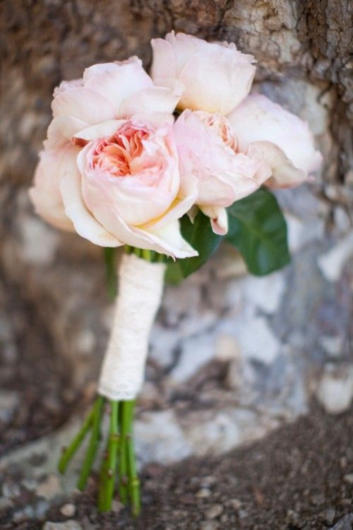 With so many bridesmaids, I would do something sweet and simple for them.  Maybe not this simple, with only the one flower variety, but definitely along this size.