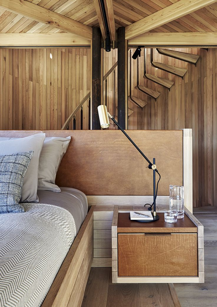 Like the built-in bed, nightstands, headboard, and other custom furniture, the staircase leading to the open-air viewing platform was made by Versfeld. The Lektor desk lamps are by Rubn.