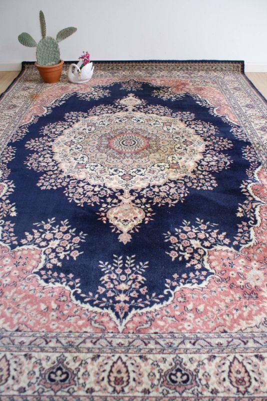 Tof vintage vloerkleed van Louis de Poortere. Wollen 'Perzisch' tapijt met Oosters sfeertje.