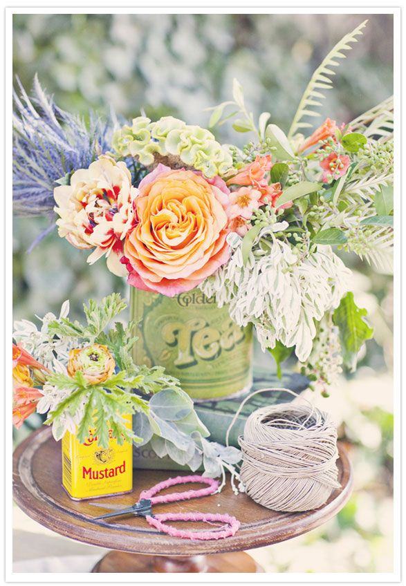 Using vintage tin cans as vases.
